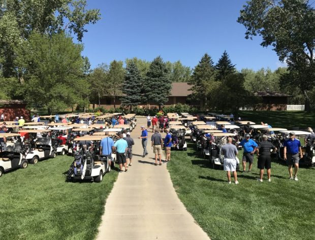 One hundred and twenty golfers line up in their carts, awaiting the shotgun start at high noon