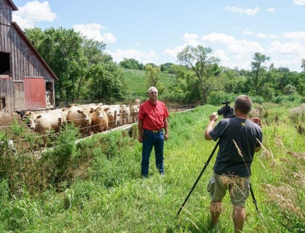 WIPCO Director is being filmed while standing in front of a barn