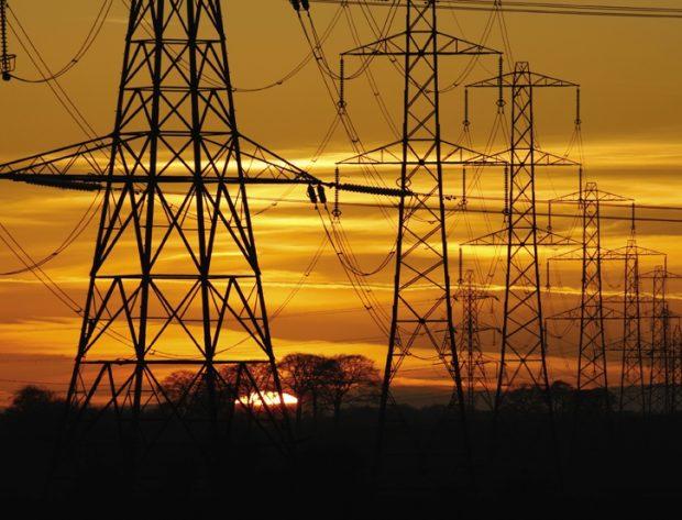 Photo image of high voltage transmission lines at sunset
