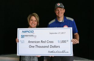 NIPCO's Exec. VP and General Manager presents Tammy Lee of the American Red Cross a check for $1,000