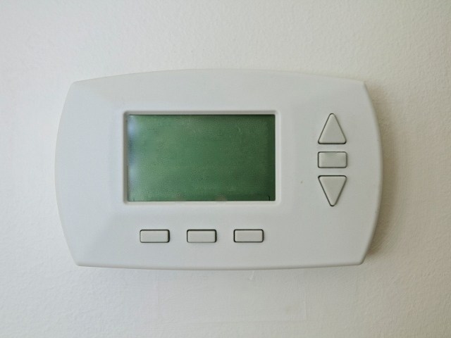 Photo image of a programmable thermostat.