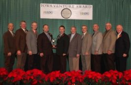 Photo above showcases employees of Valley Plating Inc of Rock Valley, staff of North West REC, and representatives from Iowa Area Development Group (IADG).