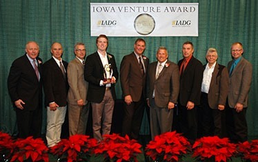 Photo above showcases employees of American Natural Processors of Galva , staff of North West REC, and representatives from Iowa Area Development Group (IADG).