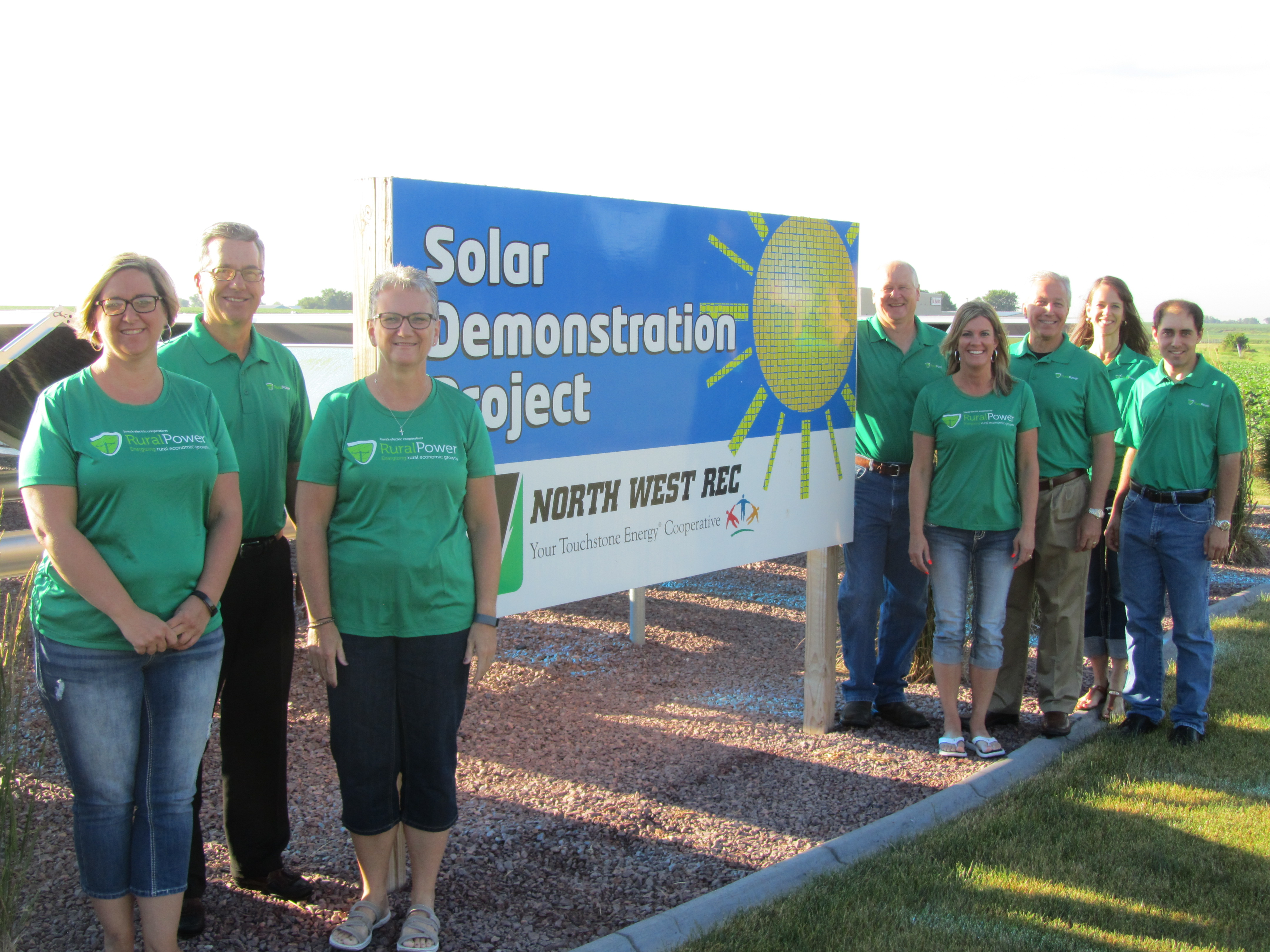 picture of NWREC employees in front of our solar demonstration project.