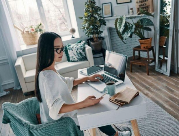 photo image of woman working from a home office