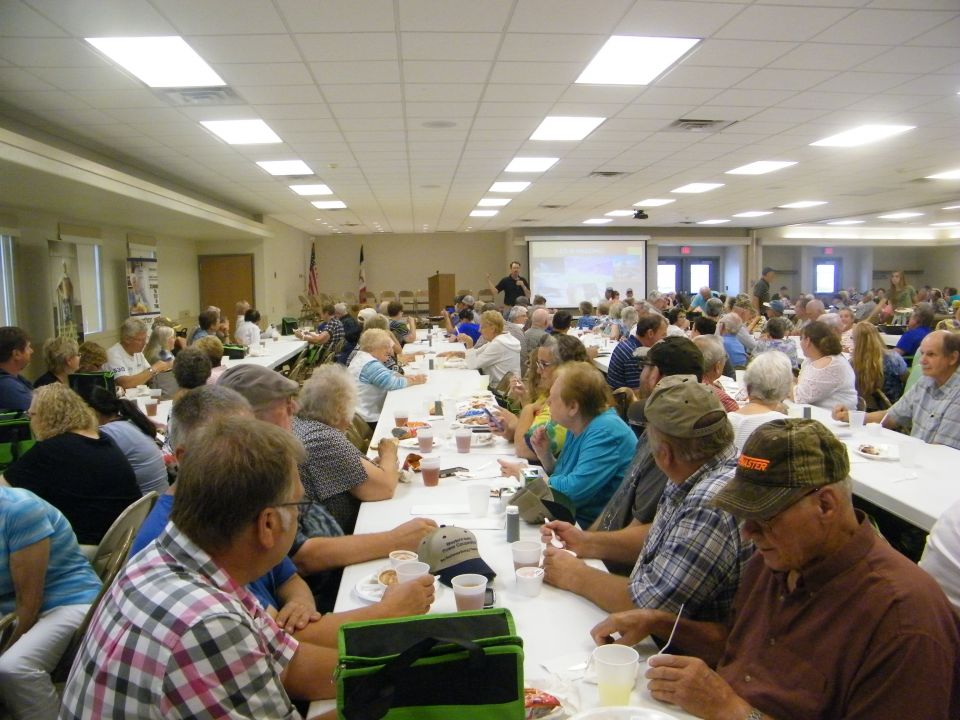 People sitting at tables during at the Annual Meeting.