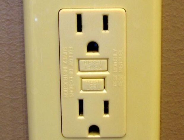 Image of GFCI outlet plug installed on a wall