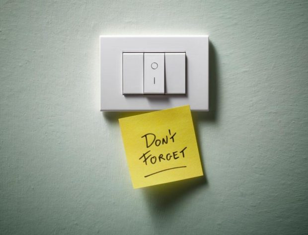 """Photo image of a light switch with a sticky note attached to it that says """"Don't forget"""""""