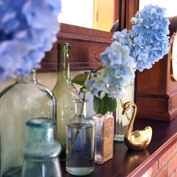 Hydrangea and vintage bottle mantle style