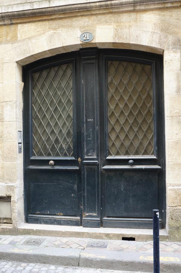 black-arched-bordeaux-door