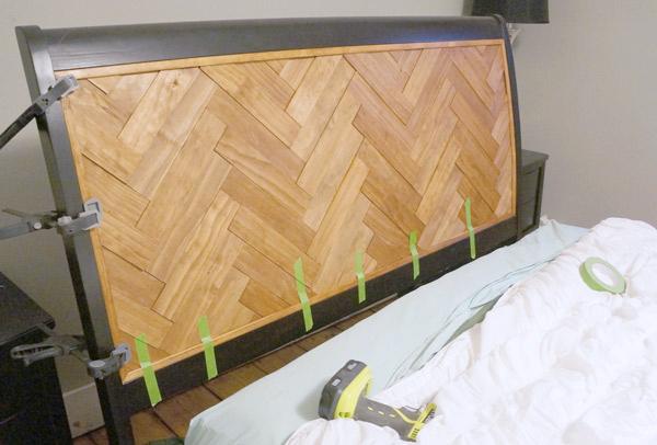 DIY Herringbone Headboard clamped via Year of Serendipity