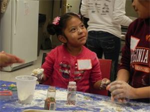 Girl making cookies with sprinkles