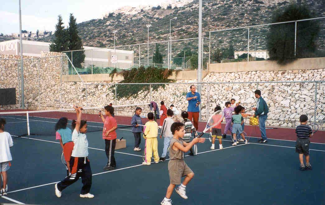 Kids Playing Tennis In Israel