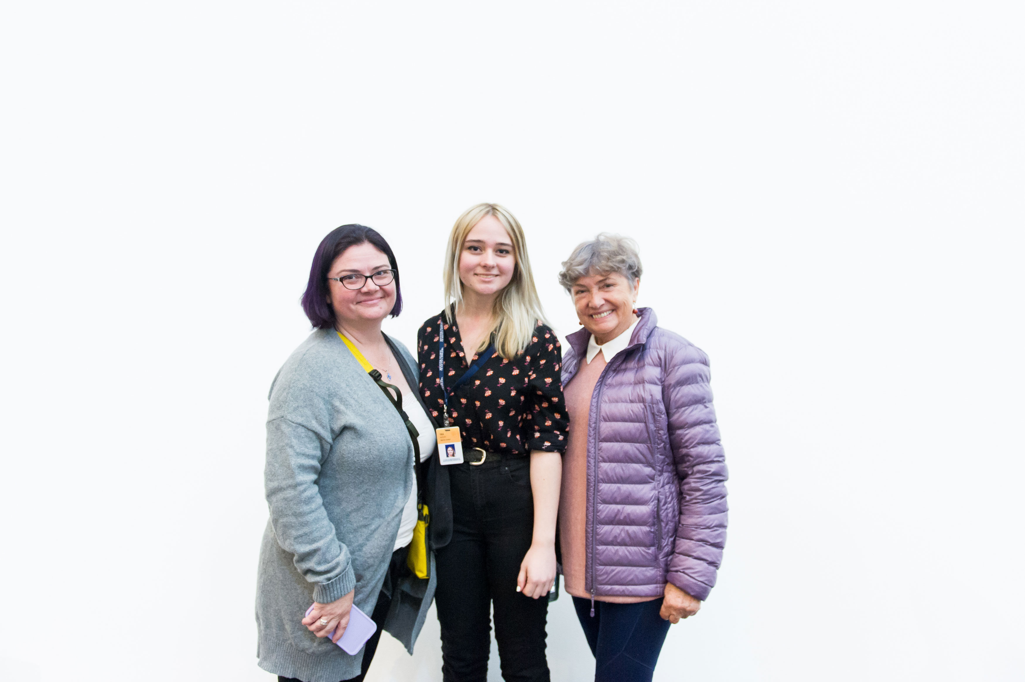Teen Art Connect intern and <em>What We Hold</em> participant Téa Kaplan with her mother and grandmother at the opening reception.