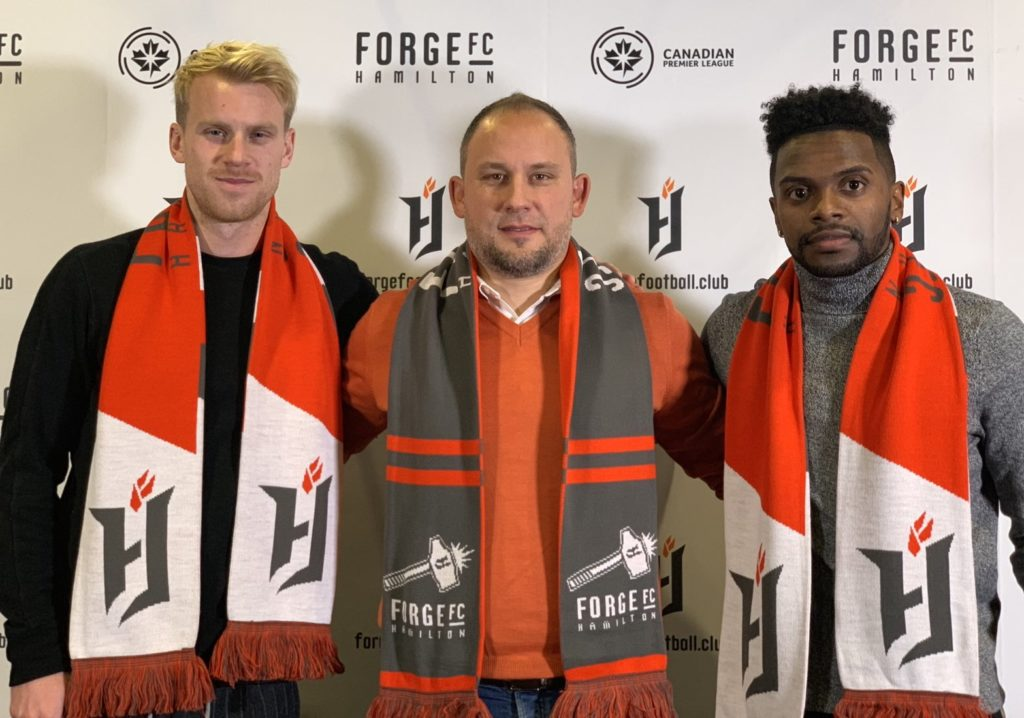 Forge FC head coach Bobby Smyrniotis with his club's first signings, Kyle Bekker and Chris Nanco. (Forge FC/Twitter)