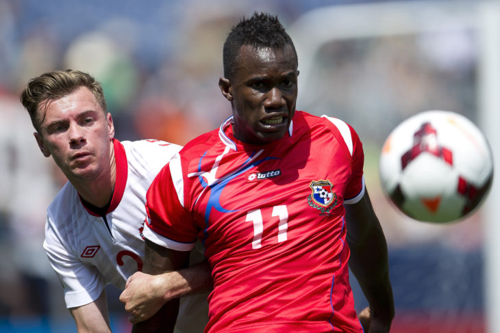 Nik Ledgerwood (L) battles with a Panamanian opponent. (Canada Soccer)