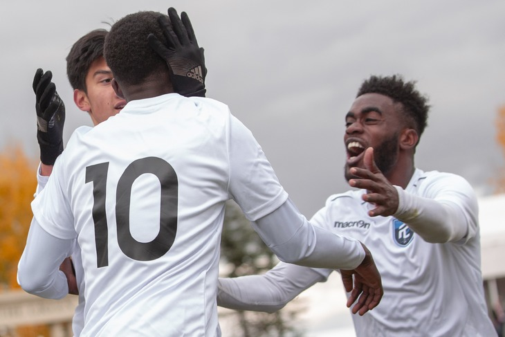Allan Zebie (R) and his FC Edmonton teammates celebrate during an 'Al Classico' friendly in 2018.