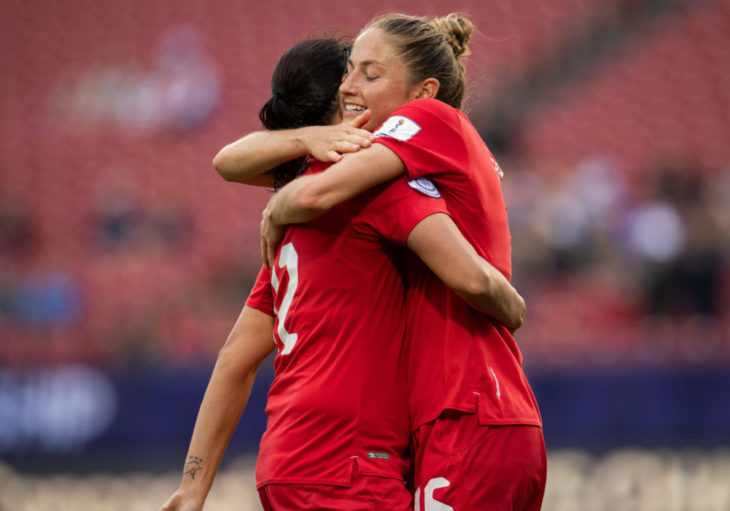 Janine Beckie celebrates a goal with Christine Sinclair. Canada Soccer)