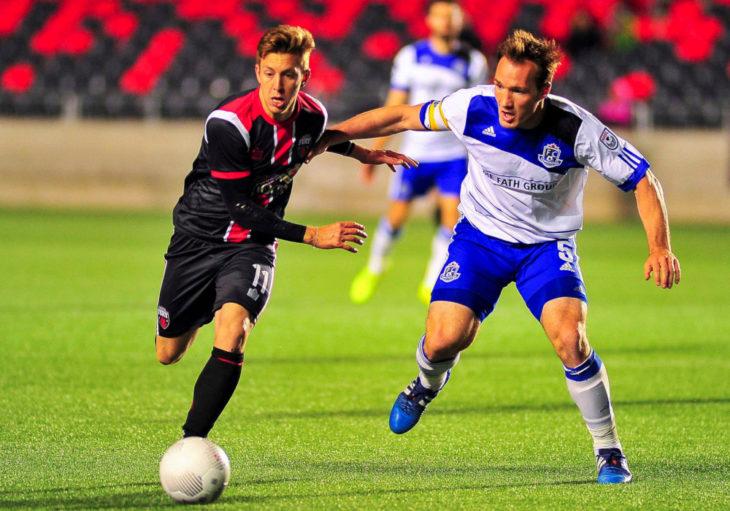 Cavalry FC striker Oliver Minatel (L) during a 2015 Canadian Championship match against FC Edmonton. (Canada Soccer)