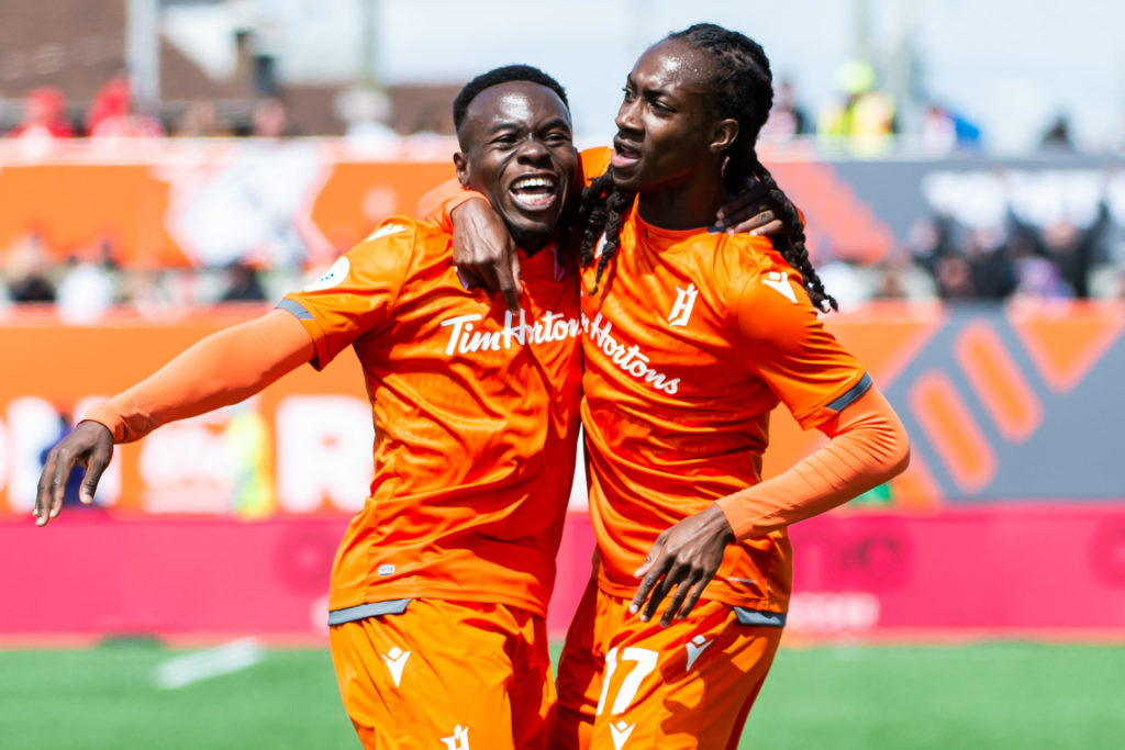 Kadell Thomas (R) and Kwame Awuah (L) celebrate Forge FC's first goal in club history. (Photo: Forge FC).