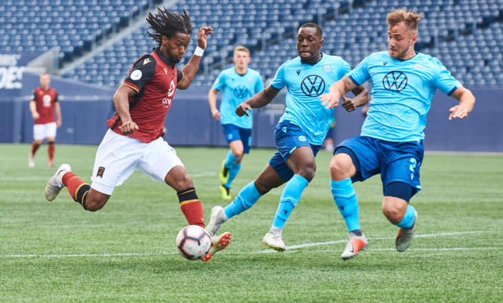 Valour's Ali Musse takes on HFX Wanderers FC defenders at Investors Group Field. (Photo: Valour FC).