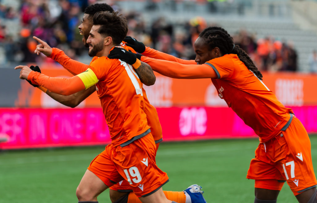 Forge FC's Tristan Borges, Kadell Thomas and Emery Welshman celebrate a goal. (Photo: Forge FC).