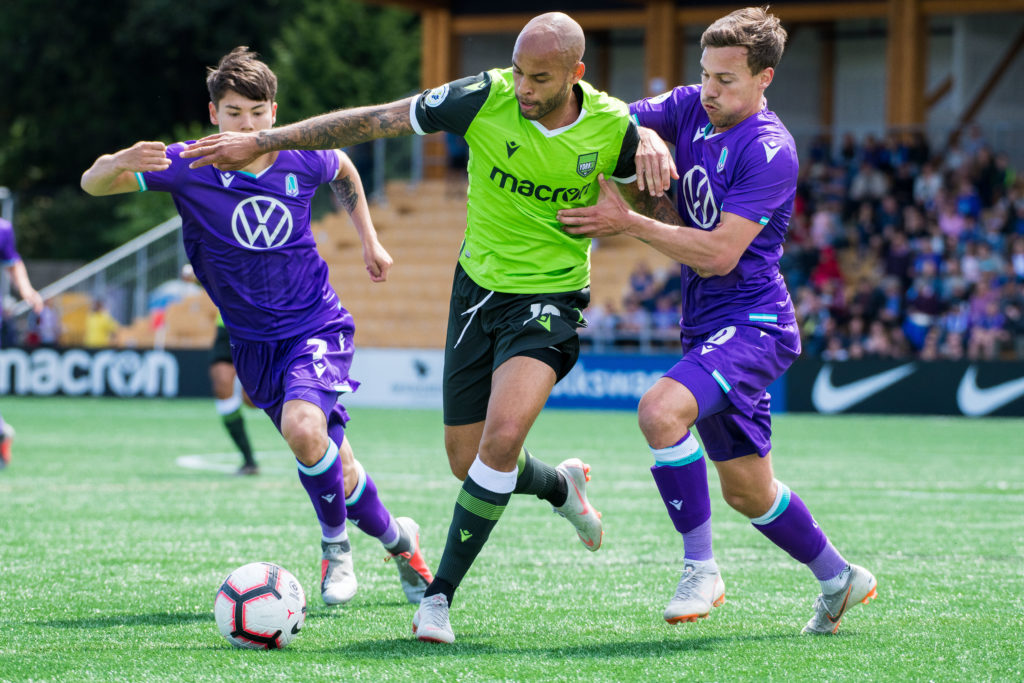 Pacific FC's Kadin Chung (L) and Ben Fisk (R) battle wiYork9's Kyle Porter (C) at Westhills Stadium. (Photo courtesy Pacific FC).