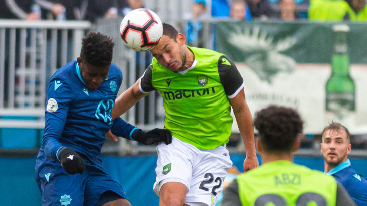 HFX Wanderers FC Defender Andre Bona (3) and York9 FC Attacker Rodrigo Gattas (22) go up for a header. (Trevor MacMillan/CPL)
