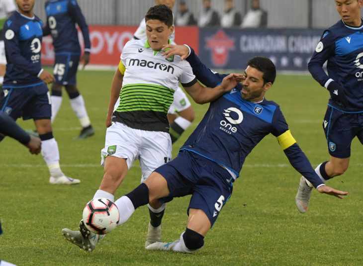 York9 midfielder Manuel Apricio (10) battles for the ball with FC Edmonton defender Ramon Soria Alonso (5) in the first half of a Canadian Championship soccer match at York Lions Stadium. (Photo: Dan Hamilton-USA TODAY Sports for CPL)