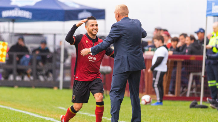 Valour FC midfielder Marco Bustos celebrates a goal with Valour head coach Rob Gale. (Trevor MacMillan/CPL).