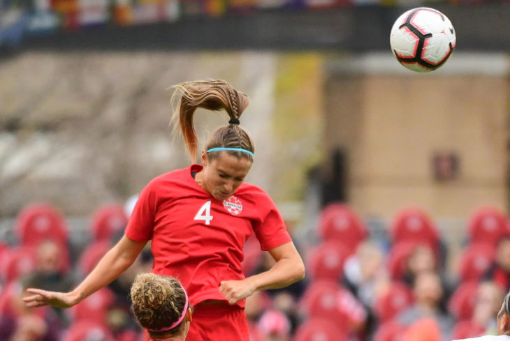 Shelina Zadorsky heads the ball away during a friendly in 2019. (Photo: Martin Bazyl/Canada Soccer).