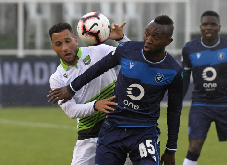 Jun 5, 2019; York, Ontario, CAN; FC Edmonton forward Oumar Diouck (45) battles for the ball with York 9 defencer Morey Doner (3) in the first half of a Canadian Championship soccer match at York University Field. Mandatory Credit: Dan Hamilton-USA TODAY Sports for CPL