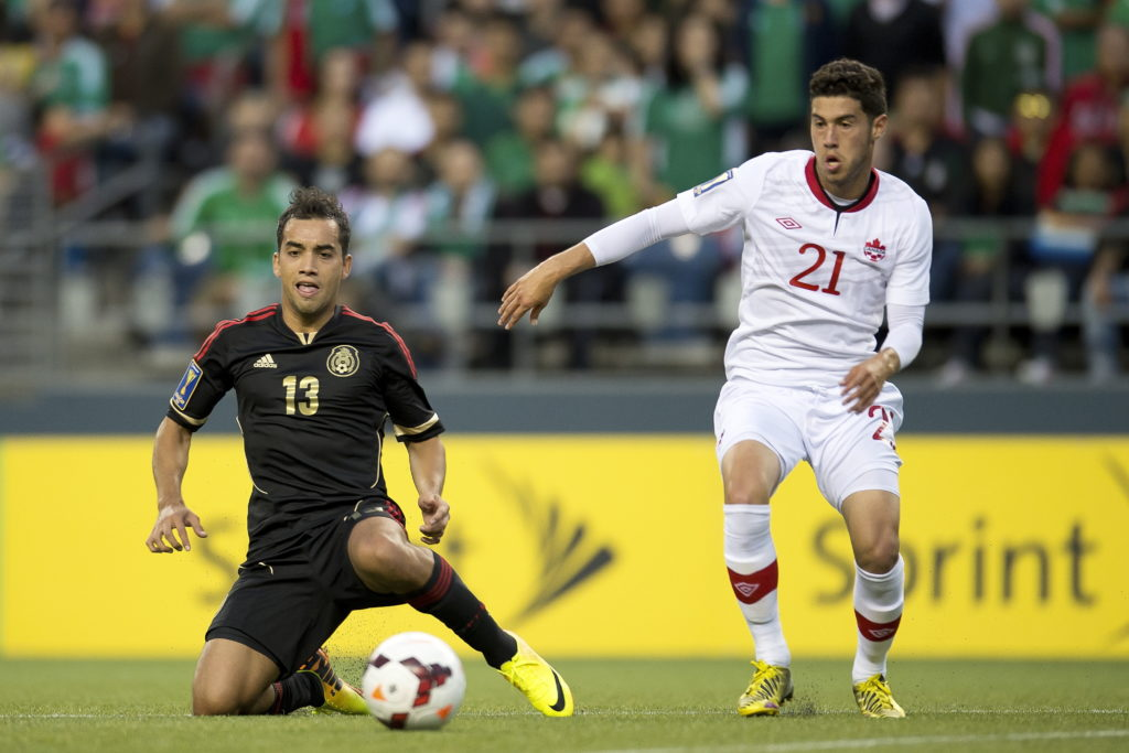 Canada's Jonathan Osorio takes on Mexico's Adrian Aldrete during a friendly in 2013. (Photo: Canada Soccer).