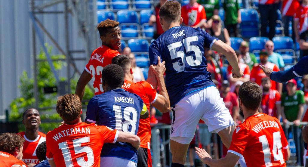 Cavalry FC and FC Edmonton players jump for the ball. (Tony Lewis/CPL).