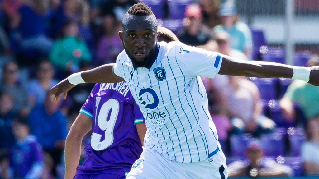 FC Edmonton forward Oumar Diouck slips past Pacific FC's Noah Verhoeven. (James MacDonald/CPL)