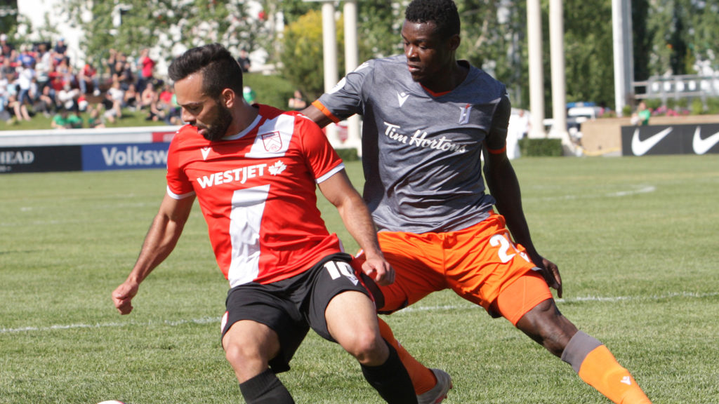 Sergio Camargo of Cavalry FC battles Bertrand Owundi for Forge FC. (Photo: Jack Cusano/CPL).