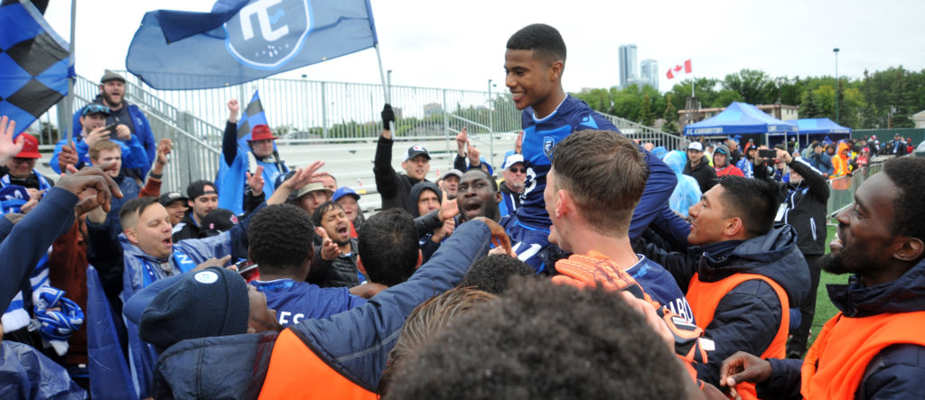 FC Edmonton forward Marcus Velado-Tsegaye (17) his held up by his fellow players as they celebrate their win and his birthday with the fans on HFX Wanderers FC at the end of the second half of a Canadian Championship soccer match at Clarke Field. (Photo: Walter Tychnowicz-USA TODAY Sports for CPL).