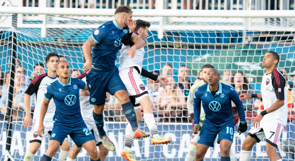 HFX Wanderer's Peter Schaale jumps for the ball amid Ottawa Fury defenders at the Wanderers Grounds in Halifax, Nova Scotia - July 10, 2019 - Scott Tanner/CPL