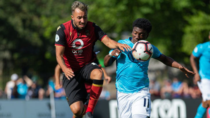 Valour FC midfielder Dylan Carreiro (and HFX Wanderers FC attacker Akeem Garcia chase a ball. (Trevor MacMillan/CPL).