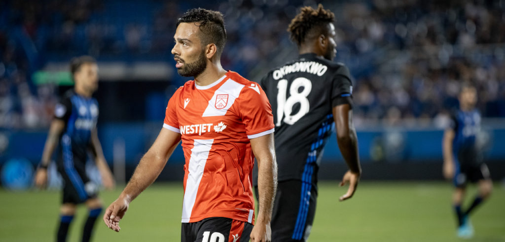 Cavalry's Sergio Camargo takes on Montreal Impact in Canadian Championship action. (Photo: Nora Stankovic).