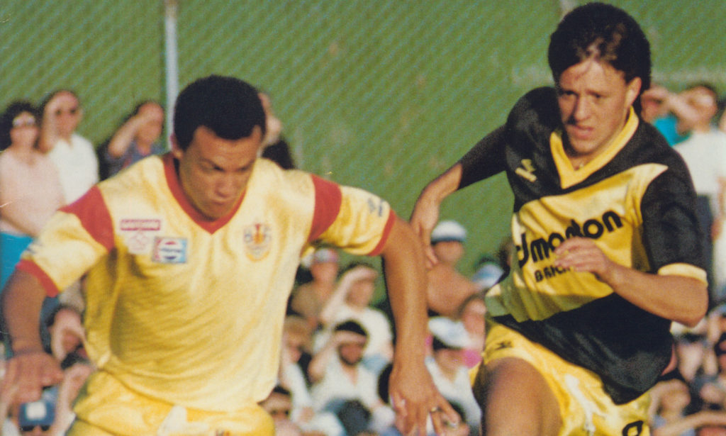 Edmonton's Ross Ongaro (R) takes on Carl Valentine (L) in 1987. (Photo: Canada Soccer).