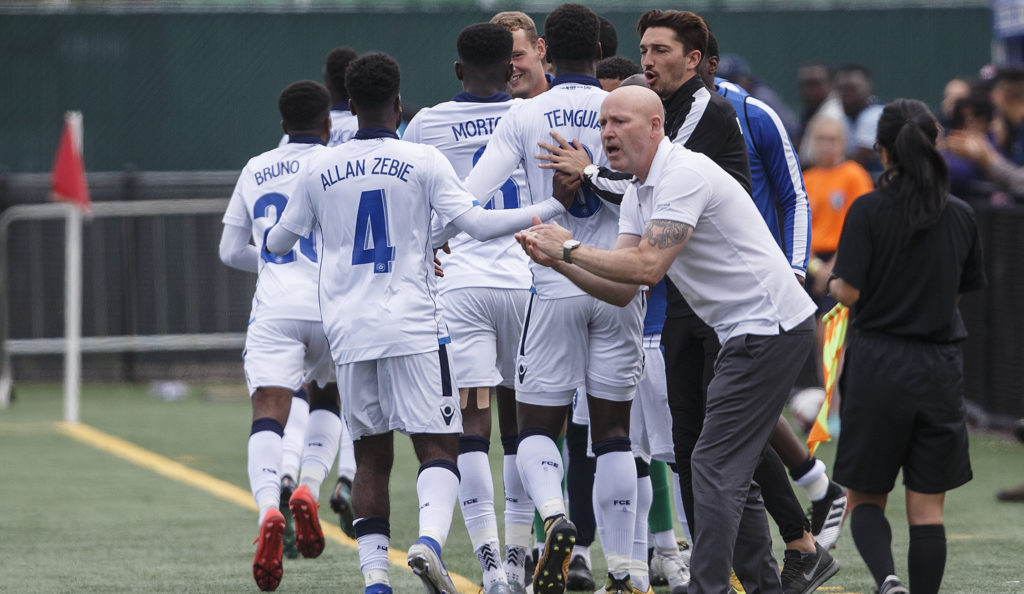 FC Edmonton head coach Jeff Paulus encourages his side after scoring a first-half goal against Pacific FC. (CPL/Jason Franson).