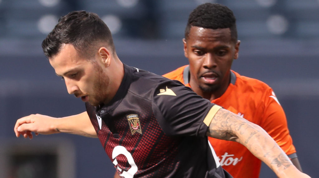 Forge FC's Chris Nanco battles for the ball with Valour FC's Marco Bustos at IG Field, Saturday August 17, 2019 (CPL)