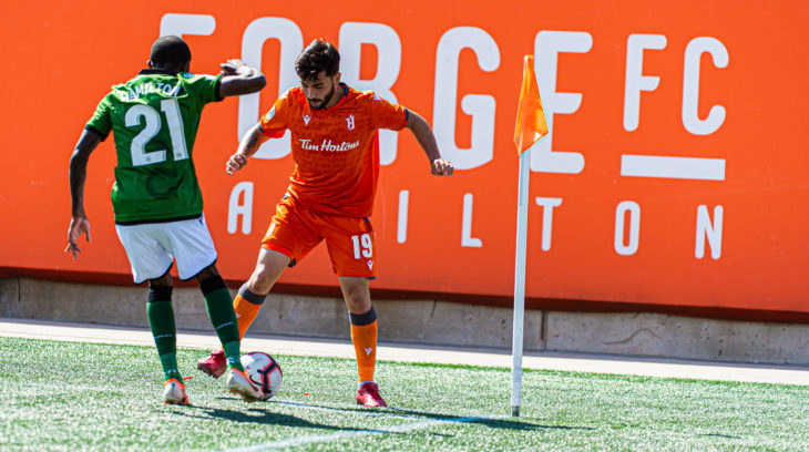 Forge FC's Tristan Borges stands down Cavalry defender Malyk Hamilton. (Ryan McCullough/CPL).