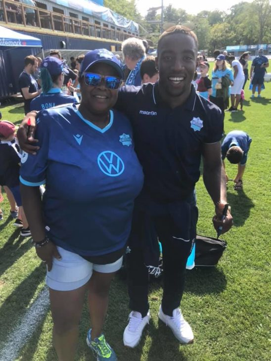 "Missy Searl with HFX Wanderers player Ndzemdzela ""Zoom"" Langwa."