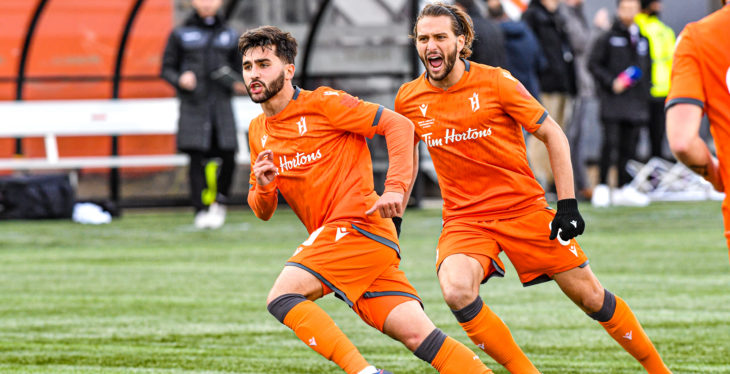 Forge FC's Tristan Borges, left, celebrates scoring against Cavalry FC. (CPL)