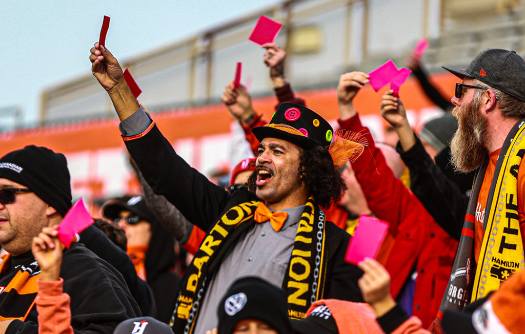 Barton St. Battalion flashing red cards toward Cavalry players at Tim Hortons Field. (Photo: CPL).
