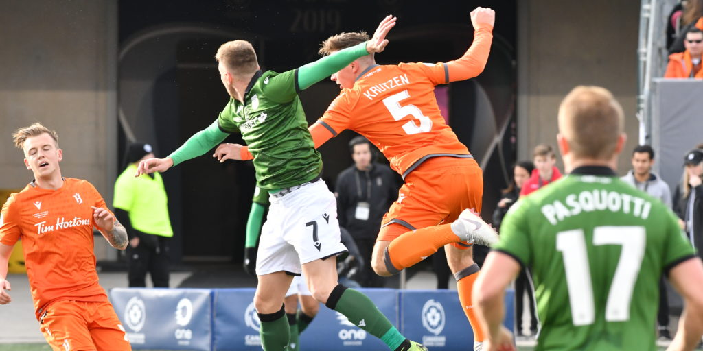 Cavalry FC's Oliver Minatel (7) battles with Forge FC's Daniel Krutzen (5). (Photo: CPL)