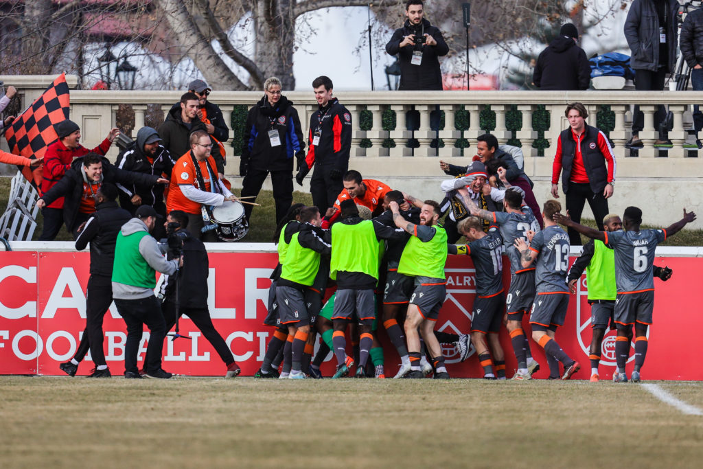 Nov 2, 2019; Calgary, Alberta, CAN; Forge FC midfielder David Choiniere (7) celebrates with teammates after agoal against the Cavalry FC in the second half during a Canadian Premier League soccer final match at Spruce Meadows. Mandatory Credit: Sergei Belski-USA TODAY Sports for CPL