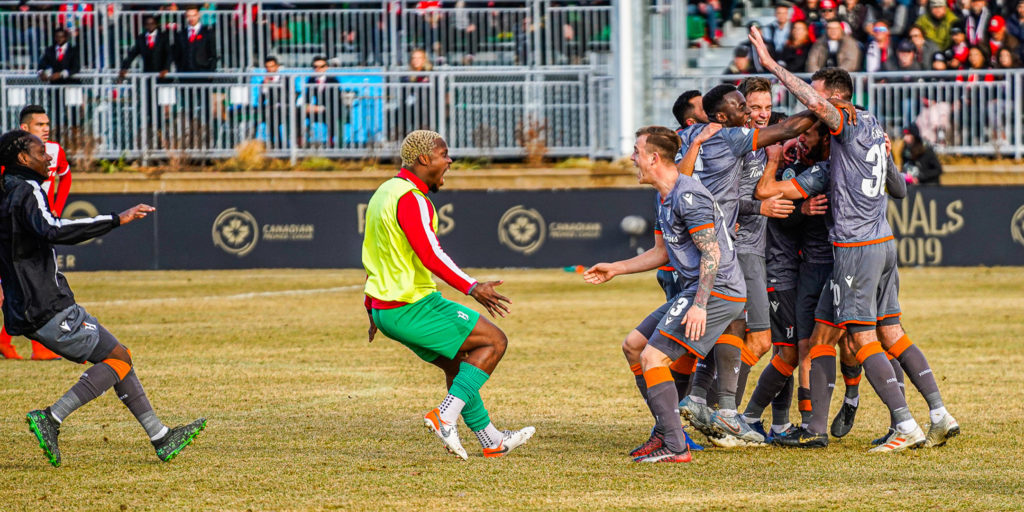 Forge FC goalkeeper Quillan Roberts and midfielder Alexander Achinioti-Jonsson come together as Forge players celebrate at the final whistle. (Photo: CPL)